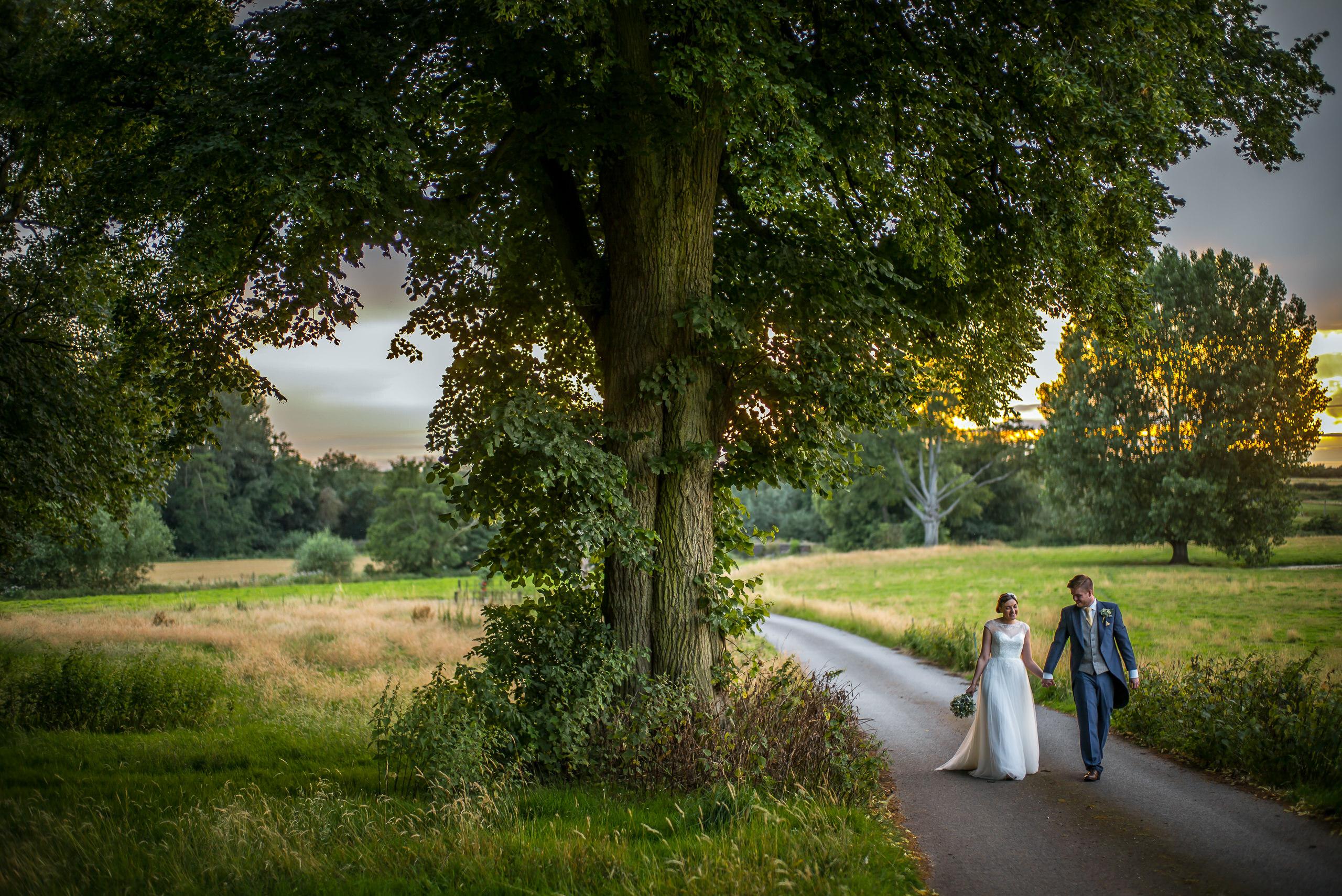 Wedding Portfolio Documentary Somerford Hall Lane Bride Walking By Brett Leica Photographer